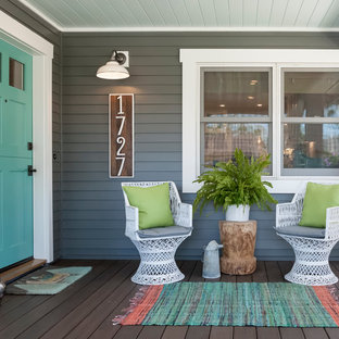 Inspiration for a transitional front porch remodel in Orange County with decking and a roof extension