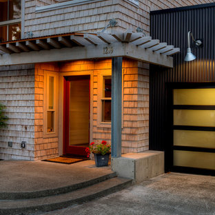Mid-sized trendy concrete front porch idea in Seattle with a roof extension