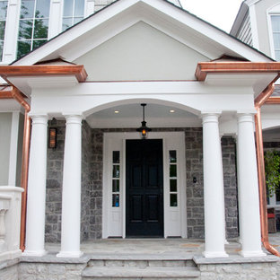 Huge eclectic stamped concrete porch idea in Nashville with a roof extension