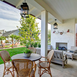 Country Side Yard Concrete Patio Photo In Orange County With A Fireplace And Roof Extension