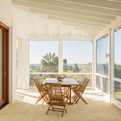 Beach style tile screened-in porch photo in Charleston with a roof extension