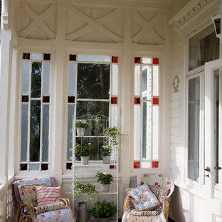Idee per un portico vittoriano con pedane e un tetto a sbalzo