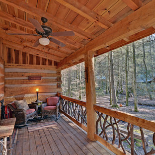 Mountain style porch idea in Atlanta with decking and a roof extension
