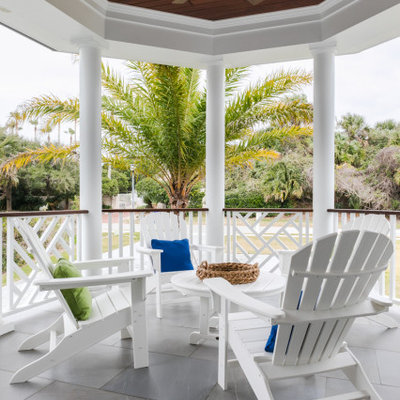 Mid-sized beach style tile back porch idea in Jacksonville with a roof extension