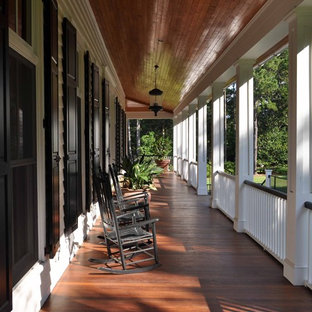 Design ideas for a large traditional verandah in Atlanta with decking and a roof extension.