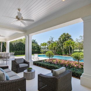 Inspiration for a mediterranean porch remodel in Miami with a roof extension