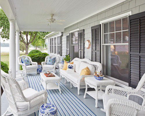 Classic Nautical Porch Classic porch idea in Baltimore with a roof extension