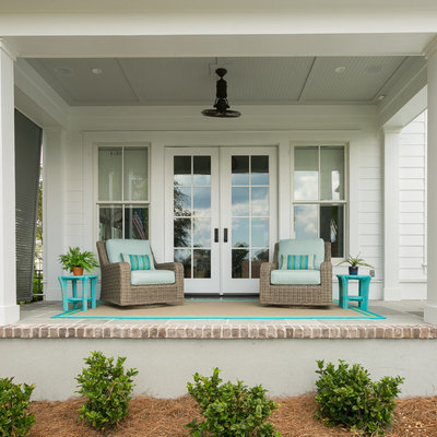 Beach style porch photo in Charleston with a roof extension