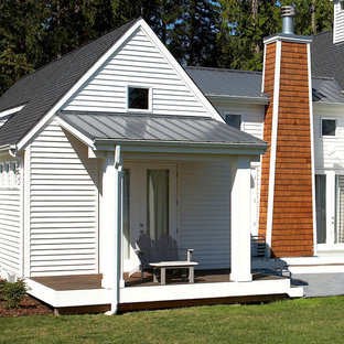 Inspiration for an eclectic porch remodel in Seattle with decking