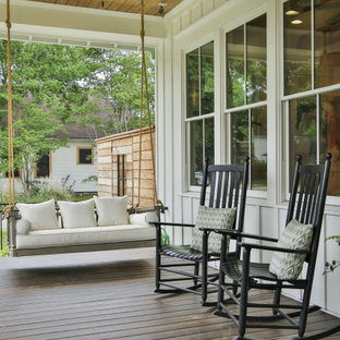 This is an example of a cottage porch design in Houston with decking and a roof extension.