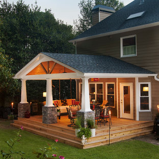 Mid-sized arts and crafts back porch idea in Atlanta with decking and a roof extension