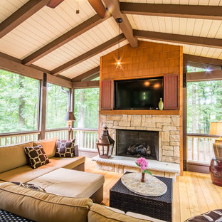 Inspiration for a large southwestern screened-in back porch remodel in Atlanta with a roof extension