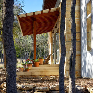 Inspiration for a small contemporary stone porch remodel in Austin