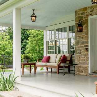 Classic back porch idea in Philadelphia with a roof extension and decking