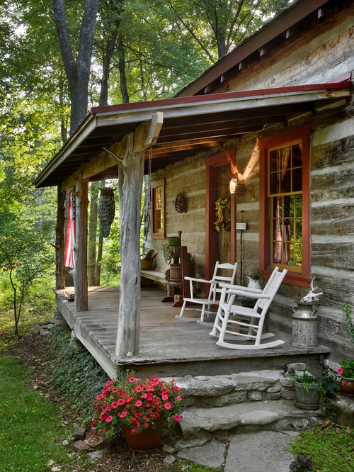 Inspiration for a rustic front porch remodel in Other with decking and ...
