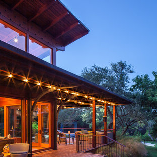 Mountain style porch idea in Austin with decking and a roof extension