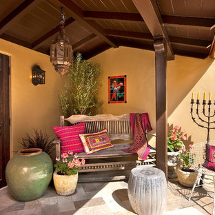 Tuscan front porch photo in Santa Barbara with a roof extension