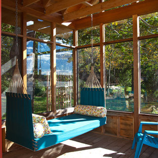 Example of a mountain style medium tone wood floor sunroom design in Boston with a standard ceiling