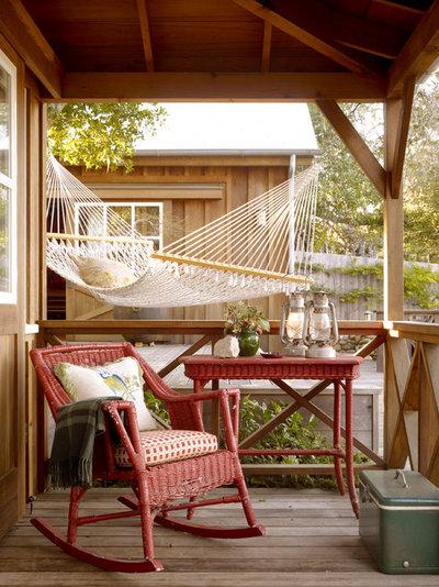 Rustic Veranda by BraytonHughes Design Studios
