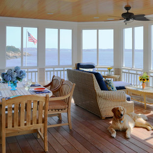 Beach style screened-in porch photo in Boston with decking and a roof extension