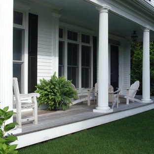Inspiration for a timeless porch remodel in Boston with decking and a roof extension