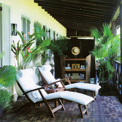 tropical porch by Jennifer Bradford Davis Interior Design