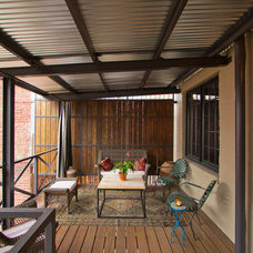 Industrial Porch by Bennett Frank McCarthy Architects, Inc.