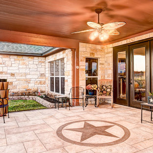 Inspiration for a mid-sized cottage stamped concrete porch remodel in Houston with a roof extension