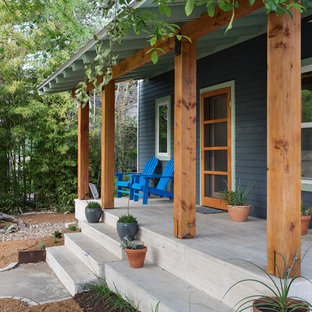 Mid-sized trendy front porch idea in Austin with a roof extension