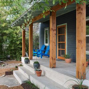 Ispirazione per un portico minimal di medie dimensioni e davanti casa con un tetto a sbalzo