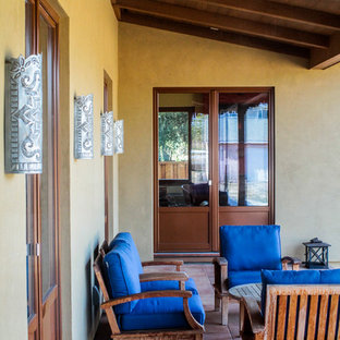 Mid-sized tuscan tile back porch idea in San Francisco with a roof extension