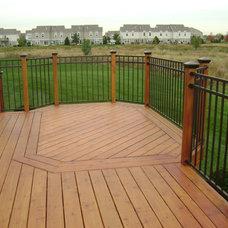 Modern Porch by Millennium Construction