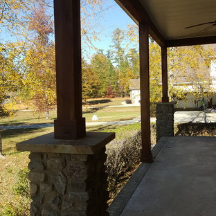 Large arts and crafts concrete front porch photo in Charlotte with a roof extension
