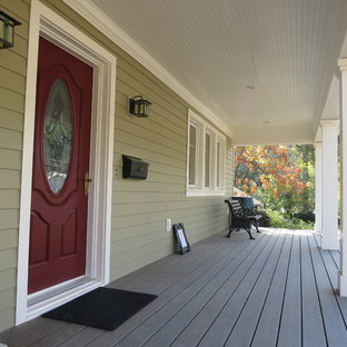 Inspiration for a mid-sized country front porch remodel in DC Metro with decking and a roof extension