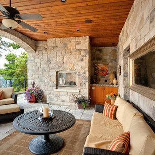 Inspiration for a mediterranean porch remodel in Philadelphia with a fire pit