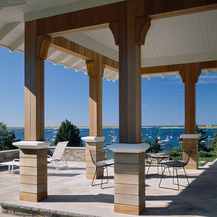This is an example of a traditional porch design in Boston with a roof extension.