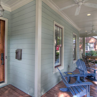 Classic front porch idea in Charlotte with decking and a roof extension