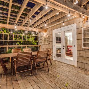 Ejemplo de terraza rústica de tamaño medio