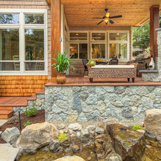 Traditional Porch by Paradise Restored Landscaping & Exterior Design