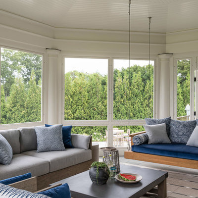 Beach style tile screened-in porch photo in New York with a roof extension