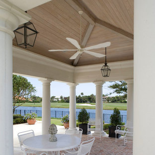 Inspiration for a large mediterranean back veranda in Jacksonville with a gazebo and an outdoor kitchen.