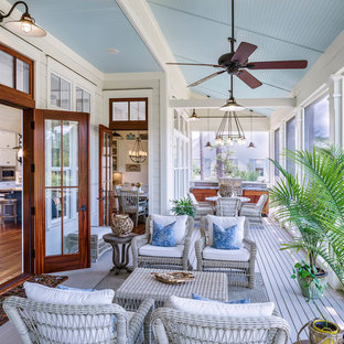 Inspiration for a large coastal screened-in porch remodel in Atlanta with a roof extension