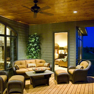 Classic porch idea in Omaha with decking