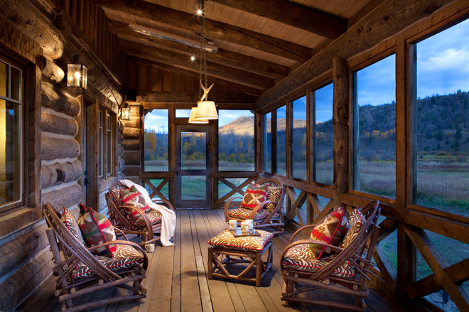 Rustic Porch by Axial Arts Architecture