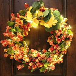 The Firefly Garden - Colorful Colorado -  Wreath - This bountiful wreath of orange Hop blossoms is a perfect way to usher in the Fall Season. Accented with warm white and amber lights this arrangement will adorn your front door or entry as guests arrive for Thanksgiving and other Fall celebrations. 20 inches in diameter. Uses 3 AA batteries.
