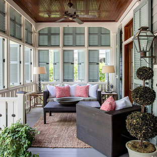 This is an example of a beach style porch container garden design in Atlanta with decking and a roof extension.