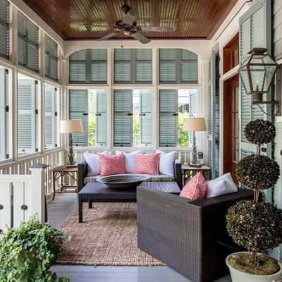 This is an example of a coastal porch design in Atlanta with decking and a roof extension.