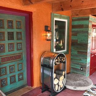 Esempio di un patio o portico american style di medie dimensioni e davanti casa con un portico chiuso