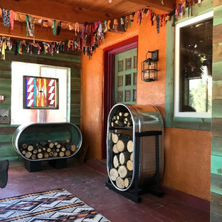 This is an example of a mid-sized southwestern screened-in front porch design in Albuquerque.