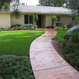 Arts and crafts stamped concrete front porch photo in San Diego